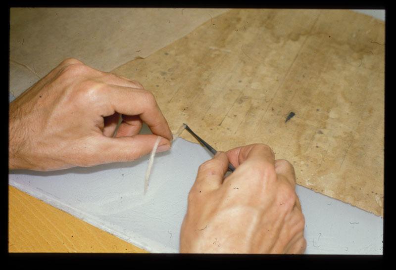 A paper conservator handling a book  TSLAC Conservation   WordPress com